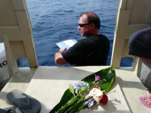 Jeff Vorfeld preparing to lower his dad's ashes into the Pacific Ocean approximately same place his grandpa's ashes were lowered 10 years ago.