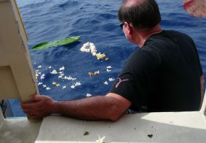 Jeff Vorfeld after lowering his dad's ashes into the Pacific Ocean approximately same place his grandpa's ashes were lowered 10 years ago.